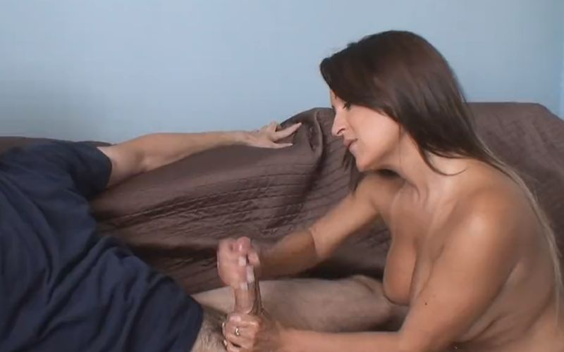 Tanned busty milf, petite and beautiful, jerks off her horny neighbour