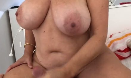 Busty mature woman gives a young man a handjob in a back alley