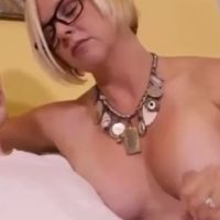 Hot busty mom gives her son a handjob
