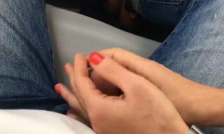 Girlfriend gives him a public handjob on a mini-bus