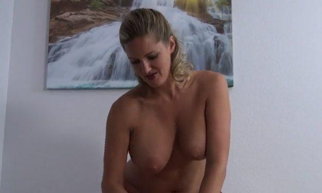 Busty mif, Zoe Holloway, gives bondaged guy a handjob